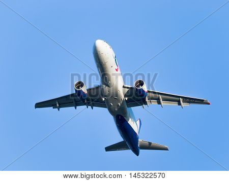 Moscow region - 31 July 2016: Large white and blue passenger plane Airbus A320-214 Ural Airlines flies to Domodedovo airport July 31 2016 Moscow Region Russia