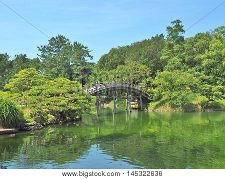 A wooden bridge - Engetsukyo in Ritsurin Garden in Takamatsu city, Kagawa Prefecture, Japan. Ritsurin Garden is one of the most famous historical gardens in Japan.