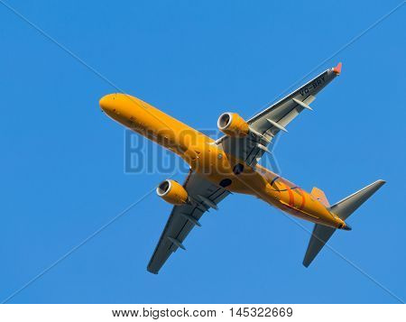 Moscow region - 31 July 2016: Big yellow passenger jet Embraer ERJ-195SR Saratov Airlines flies to Domodedovo airport July 31 2016 Moscow Region Russia