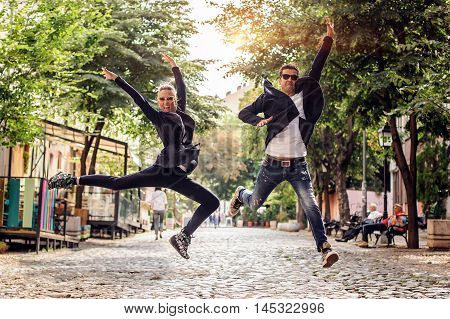 Attractive Woman And Handsome Man Jumping On The Street