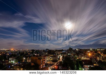 Full moon night in Patan, Nepal. Long exposure, motion blur in the clouds.