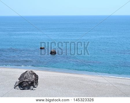 The rock look like turtle on the beach with the sea in the background at Katsurahama Beach, Kochi Prefecture on the island of Shikoku, Japan.