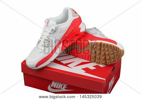 BURGAS BULGARIA - AUGUST 29 2016: Nike Air MAX lady's - women's shoes - sneakers - trainers in white and orange illustrative editorial over Nike shoes box isolated on white background