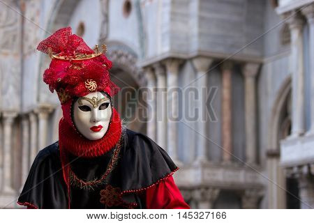 VENICE ITALY - FEB 6 2013: Costumed person on the Piazza San Marco during Venice Carnival.