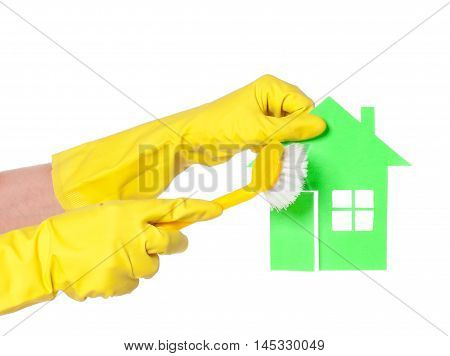 Woman hands holds paper house isolated on white background