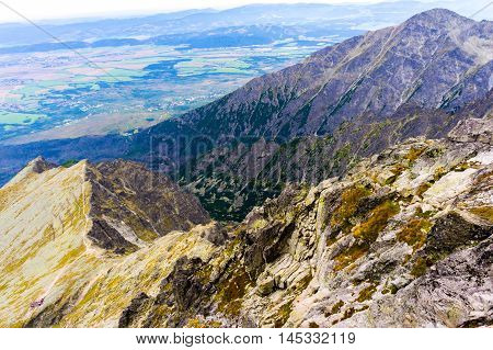 landscape with mountains in slovakia, high tatras, great view from the heights, distant villages and fields visible on the ground