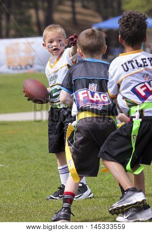 FLAGSTAFF, ARIZONA, MAY 14. Foxglenn Park on May 14, 2016, in Flagstaff ,Arizona. A flag football game for 5 and 6 year olds at Foxglenn park in Flagstaff Arizona.
