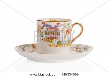 Antique coffee cup and saucer on a white background