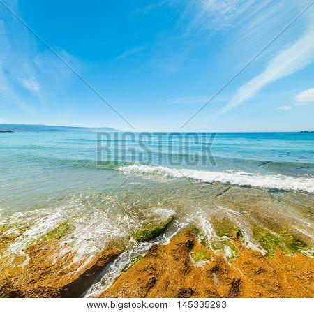 yellow rocks in Le Bombarde beach Sardinia