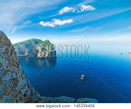 beautiful rocks in Capo Caccia bay with Foradada island on the background
