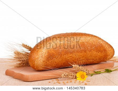 Fresh bread with caraway seeds on a cutting board on white background