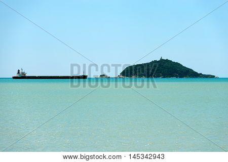 Empty silhouette of a container ship (Bulk Carrier) in the Gulf of La Spezia or Gulf of poets (Golfo dei poeti) Tino Island. La Spezia Liguria Italy