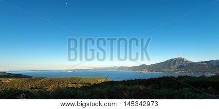 Lago di Garda (Garda Lake) the largest Italian lake of glacial origin. The Veneto coastline in the foreground in the background the coast of Lombardy