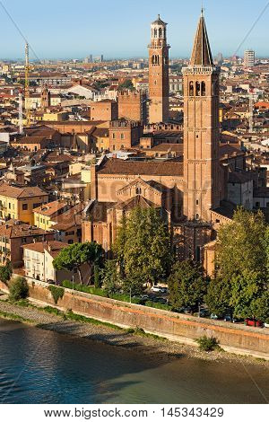 View of Verona with the church of St. Anastasia (1290-1471) and the medieval tower of Lamberti (XI century - 84 m.). UNESCO world heritage site - Veneto Italy