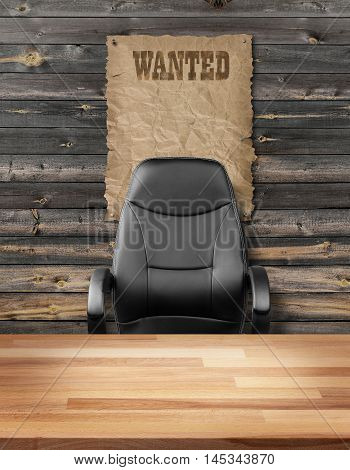 Empty executive chair in front of a rough wall with wanted poster
