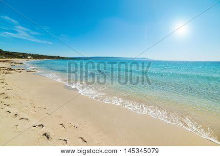 shining sun over Le Bombarde beach Sardinia