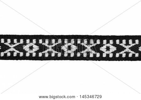 Black and white embroidered ribbon on white background