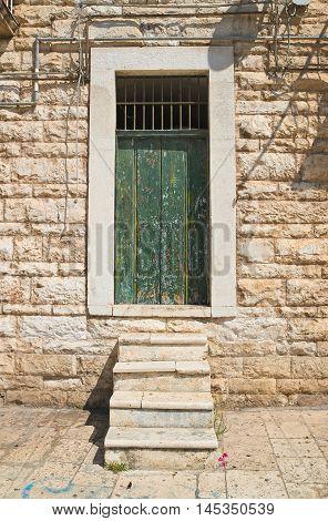 Detail of a wooden door. Molfetta. Puglia. Italy.
