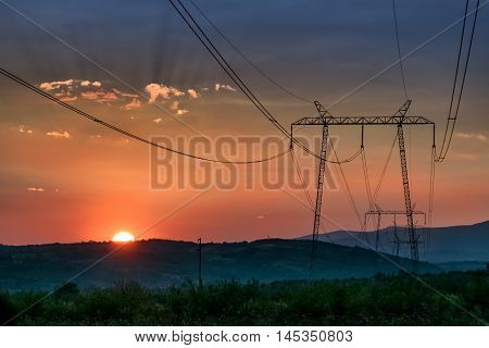 Power line Transmission towers in the sunset