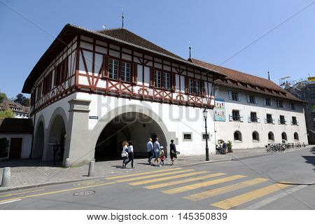 LUCERNE SWITZERLAND - MAY 08 2016: Arcades under which passes the leaving the Spreuer Bridge on the left side of the river Reuss and The Museum of History that is located in the ancient armoury
