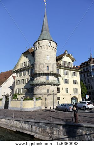 LUCERNE SWITZERLAND - MAY 5 2016: Haus zur Gilgen one of the oldest stone houses in the city and is located on the right bank of the river Reuss.
