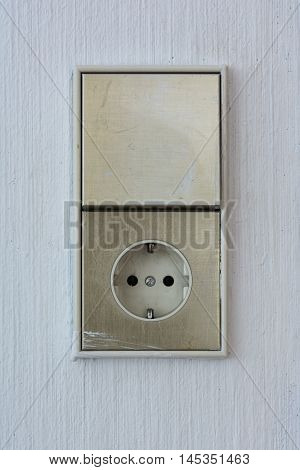 Vertical Disconnected European Outlet Light Switch Wall Texture Background