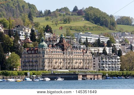 LUCERNE SWITZERLAND - MAY 05 2016: Palace Luzern it is a 5-star hotel facing to Lake Lucerne was built in 1906. Nowadays the hotel offers 129 rooms and suites in the Belle Epoque style