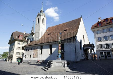 LUCERNE SWITZERLAND - MAY 04 2016: St. Peter Chapel (St. Peterskapelle) is located in the Chapel square (Kapellplatz) in old town