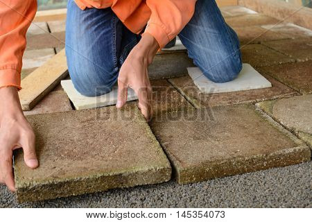 Skilled workers paving Flooring with stone slabs