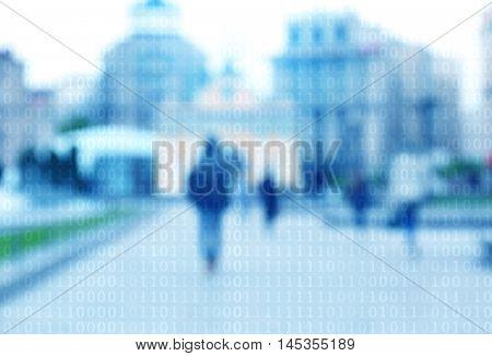 Binary code on blurred city street background.