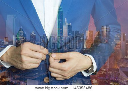 Man in blue suit two bottons doing button. Double exposure elegant man and big city at night with many city light showing big city dress code. Business casual dress double exposure.