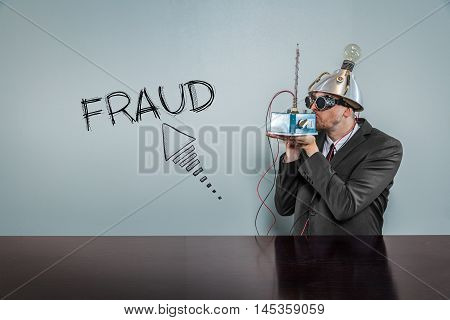 Fraud text with vintage businessman kissing machine