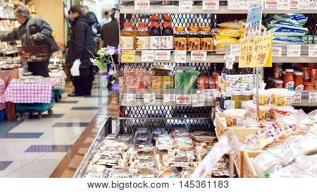 Osaka, Japan - March 2015: People walking and shopping in Supermarket in Japanese local store