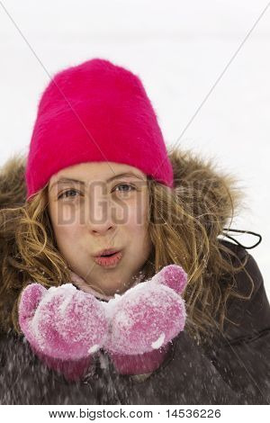 Teen Blowing Snow