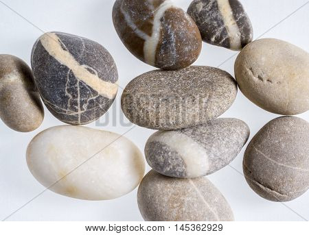 rounded stone pebble arrangement in light grey back