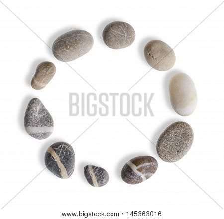 circular arrangement with small pebbles in white back with shadow seen from above