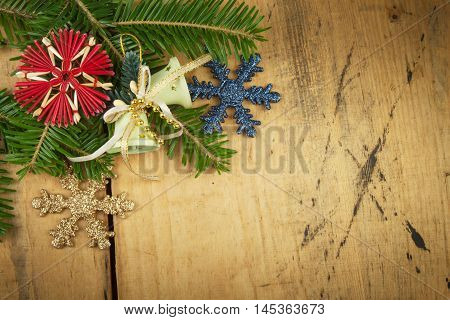 Christmas decoration on a wooden board. Christmas background. Christmas fir tree with decoration on a wooden board. Christmas background with balls and decorations over wooden table
