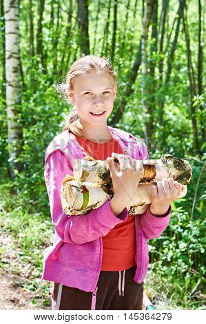 Young Girl Carries Firewood From Forest
