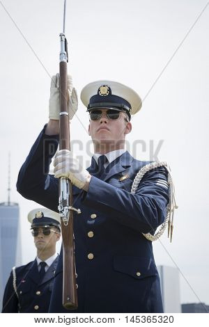 JERSEY CITY NJ MAY 29 2016: The US Coast Guard Ceremonial Honor Guard Silent Drill Team perform movements with fixed bayonets on rifles in Liberty State Park during Fleet Week NY.