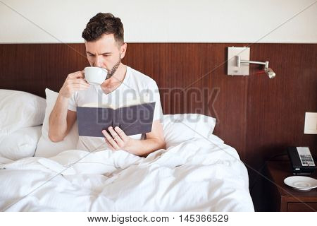 Drinking Coffee And Reading A Book