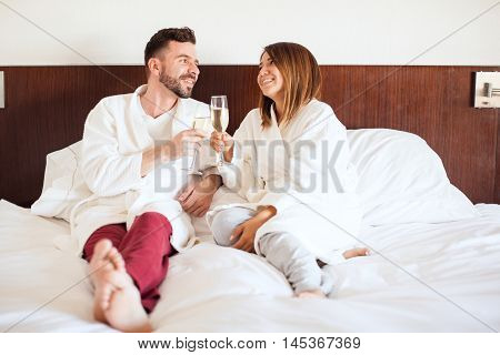 Honeymooners Celebrating In A Hotel