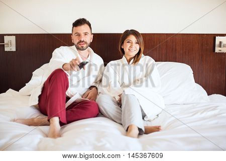 Cute Couple Watching Tv At A Hotel