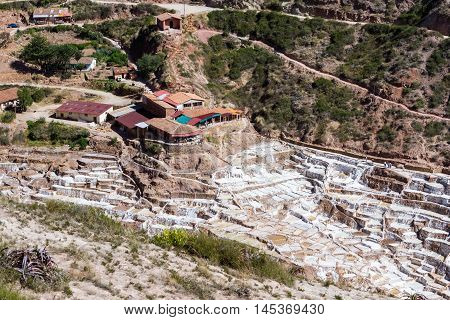 Maras Peru -May 18 : Salt mines in Maras Peru using the sunshine to evaporate the water. May 18 2016 Maras Peru.