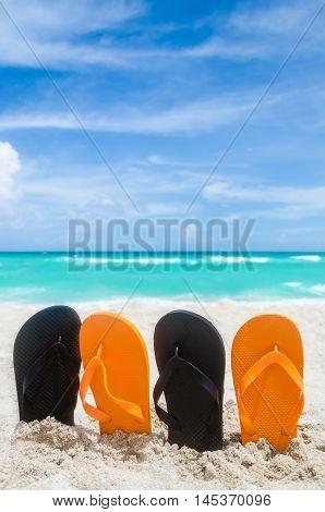 Ocean Halloween background with orange and black flip flops