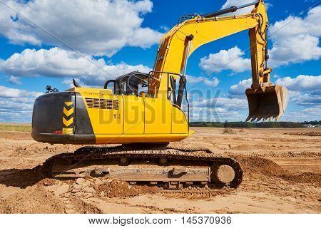 Loader excavator at sandpit during earthmoving works