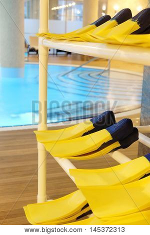 Store of flippers in a swimming pool