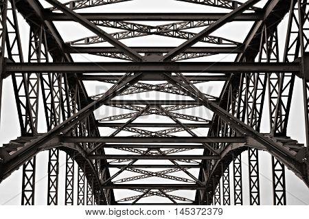 Metal roof of old truss bridge Hamburg Germany. Very subtle warm tone added