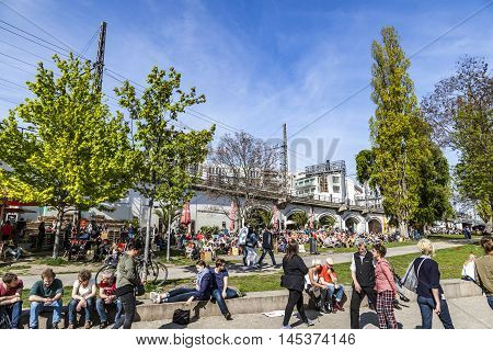People Enjoy The Summer At The Spree Promenade