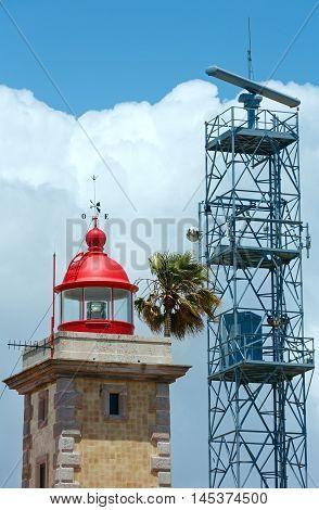 Lighthouse top on sky background (Ponta da Piedade cape Lagos Algarve Portugal).