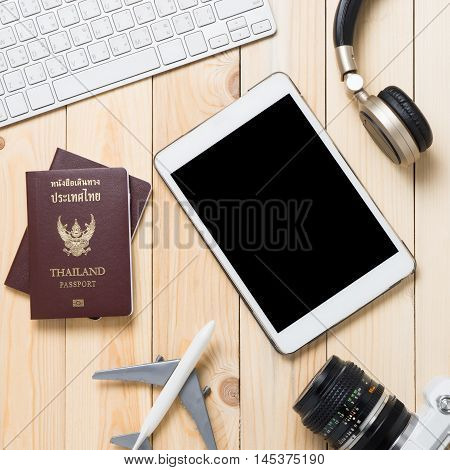 Blank Tablet screen for travel website agency with travel accessory